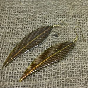 Handmade gold glittery leaf earrings